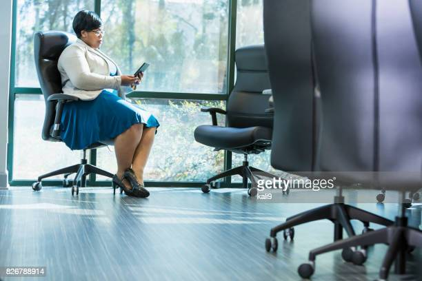 african-american businesswoman using digital tablet - black skirt stock pictures, royalty-free photos & images