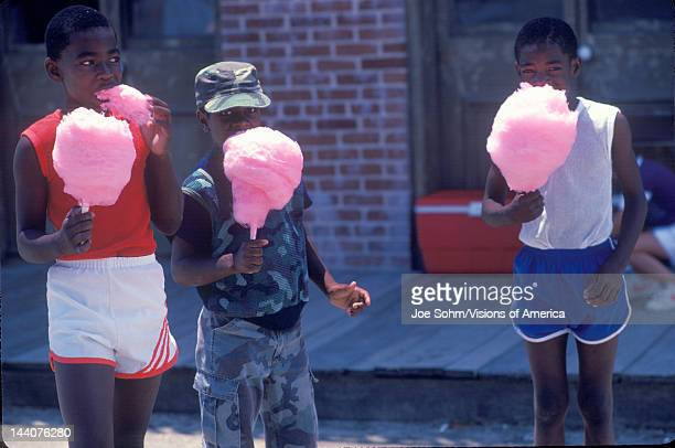 AfricanAmerican children eating cotton candy NatchezMI