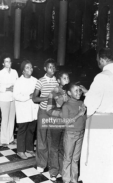 AfricanAmerican children in a church during an Ash Wednesday event Original Caption Reads 'Ash Wednesday'