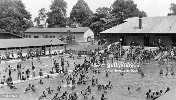 African-American children in a segregated swimming pool at Druid Hill Park, Baltimore, Maryland, 1955.