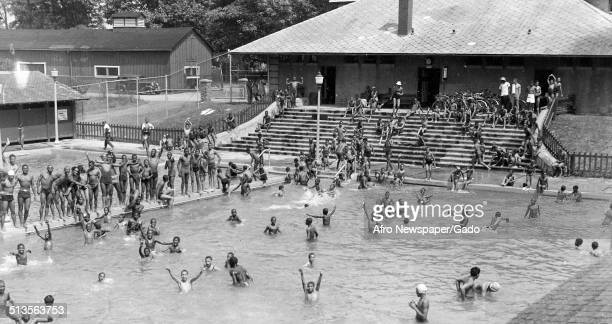 African-American children in a segregated swimming pool at Druid Hill Park, Baltimore, Maryland, July 4, 1940.
