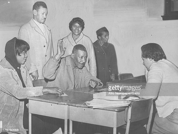 AfricanAmerican citizen Victor Williams registers to vote at Dunbar High School in last few days of voter registration Washington DC March 21 1964
