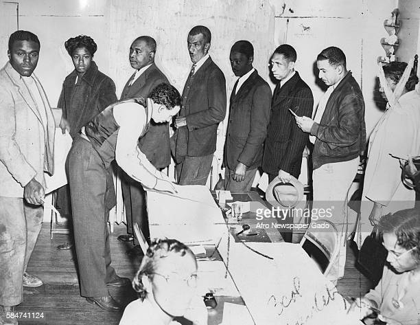 African-American citizens line up to vote in an election in Catonsville, Maryland, November 9, 1946. .