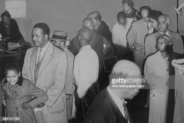 AfricanAmerican citizens stand in line and vote during an election Baltimore Maryland 1946