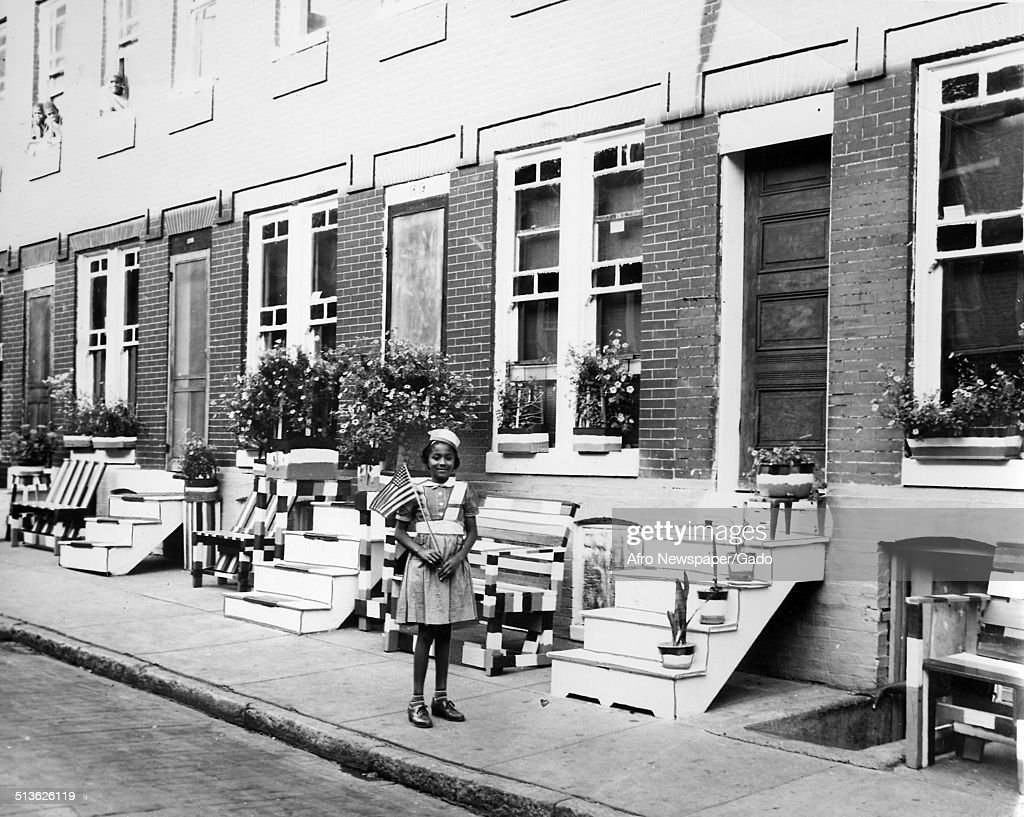 African-American citizens, with row houses, during the Afro American Newspapers Clean Block campaign, Baltimore, Maryland, August 20, 1949.