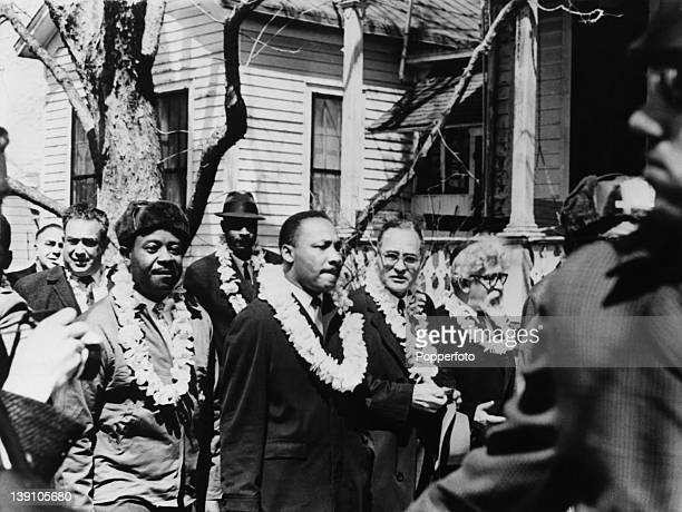African-American civil rights activist Martin Luther King, Jr in the front line of the third march from Selma to Montgomery, Alabama, to campaign for...
