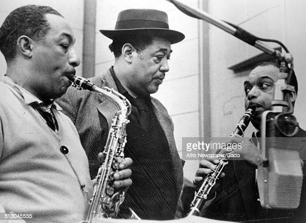 AfricanAmerican composer pianist bandleader and Jazz musician Duke Ellington and a Jazz orchestra in a recording studio 1960