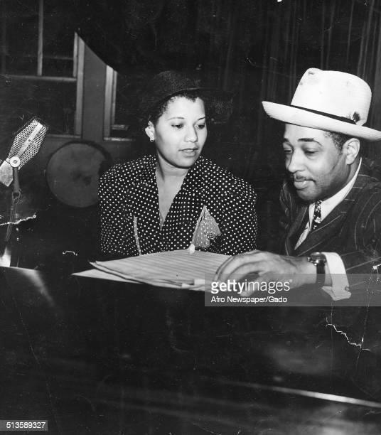 AfricanAmerican composer pianist bandleader and Jazz musician Duke Ellington and Jean Eldridge in a recording studio August 6 1938