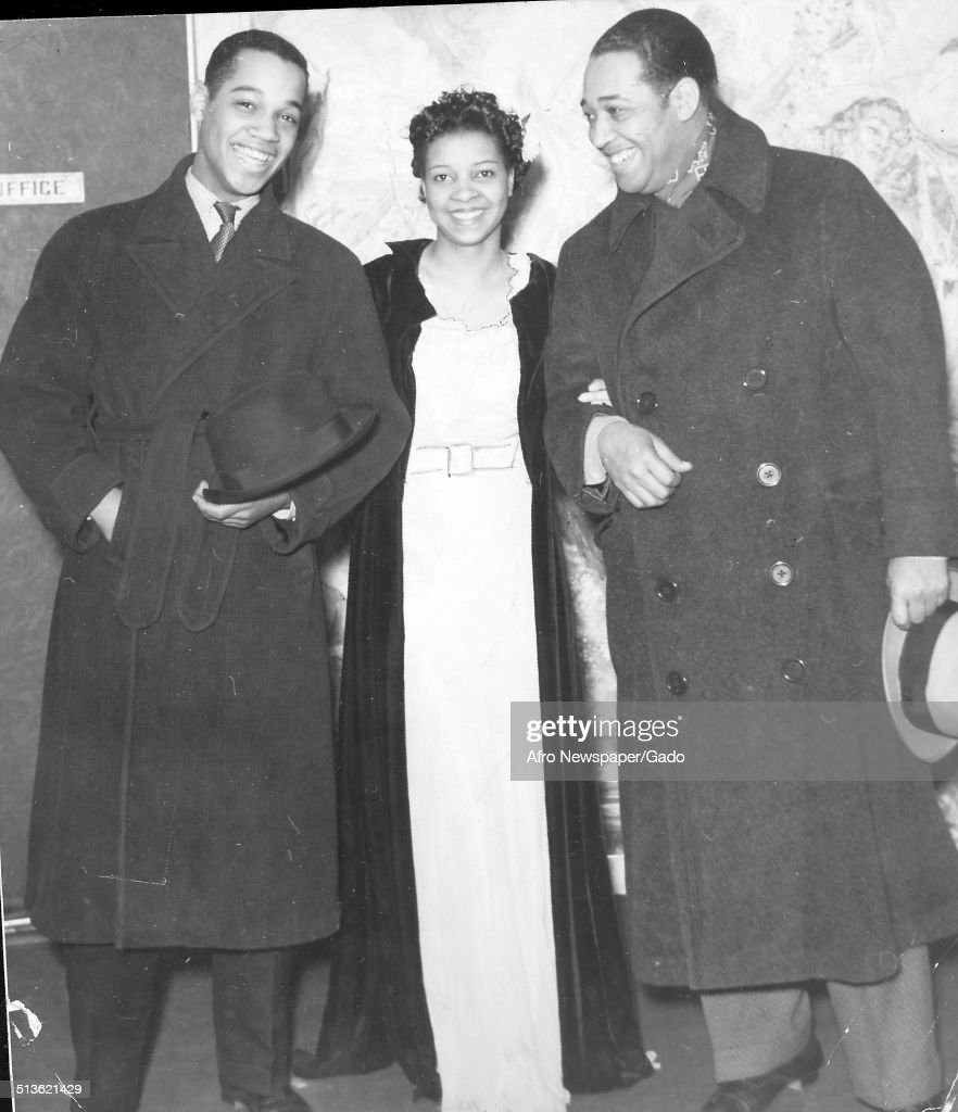 African-American composer, pianist, bandleader and Jazz musician Duke Ellington, Mercer Kennedy Ellington and Jeni LeGon smiling at the Cotton Club during a birthday party for Fayard Nicholas , New York City, New York, April 10, 1937.