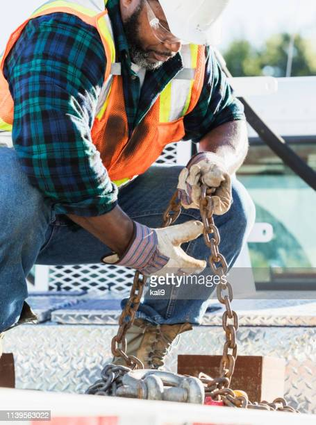 African-American construction worker on a crane