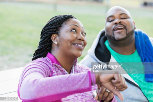 African-American couple, checking fitness tracker