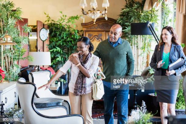 african-american couple shopping in furniture store - showroom stock pictures, royalty-free photos & images