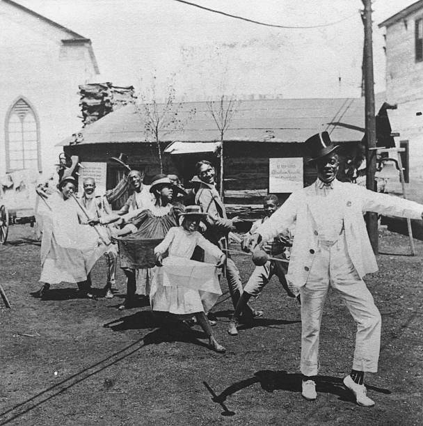 African-American dancers perform the Cakewalk at the...