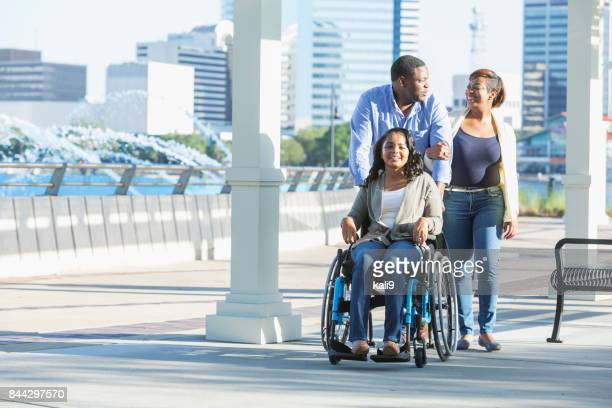 African-American family, daughter in wheelchair