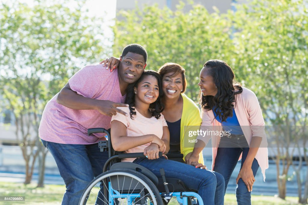African-American family, daughter in wheelchair : Stock Photo