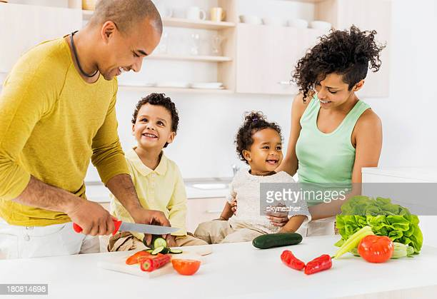 African-American family having fun in the kitchen.