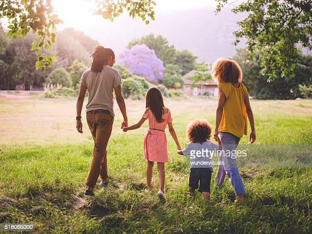 African-american family taking a walk in a beautiful park