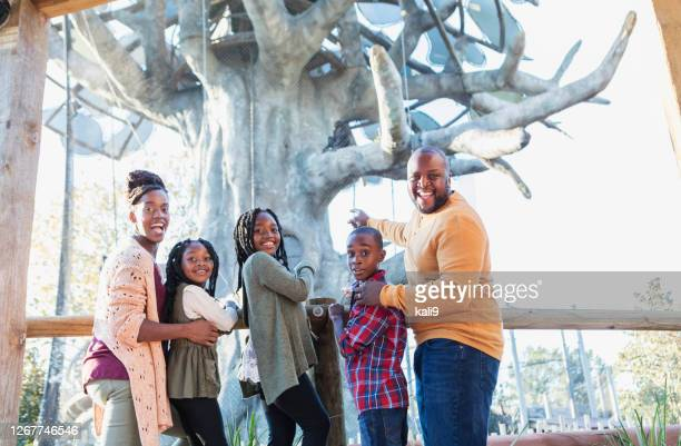 african-american family visiting the zoo - five people stock pictures, royalty-free photos & images