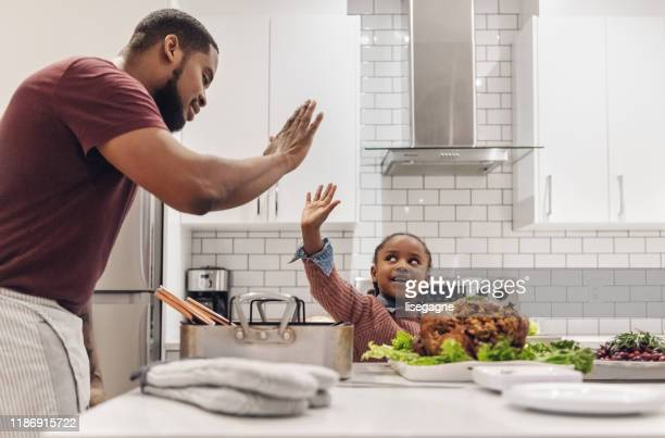african-american father and daughter preparing thanksgiving dinner - kids thanksgiving stock pictures, royalty-free photos & images