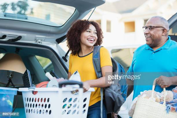 african-american father helping daughter move - leaving stock pictures, royalty-free photos & images