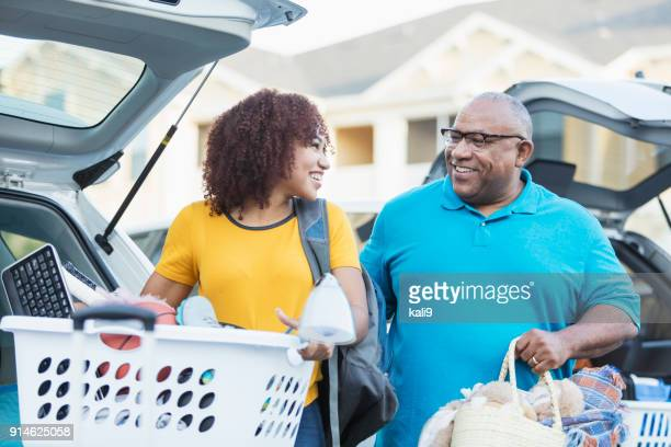 African-American father helping daughter move