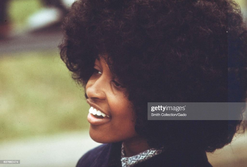 A African-American female student with large afro hair at the Westinghouse Industrial Vocation School on Chicago's west side, Chicago Illinois, May, 1973. Image courtesy John White/US National Archives. (Photo via Smith Collection/Gado/Getty Images).