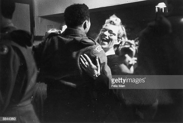 A AfricanAmerican GI dancing with a white girl at the Bouillabaisse Club in London's New Compton Street Soho 17th July 1943 Picture Post 1486 Inside...
