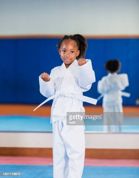 african-american girl learning taekwondo - martial arts stock pictures, royalty-free photos & images