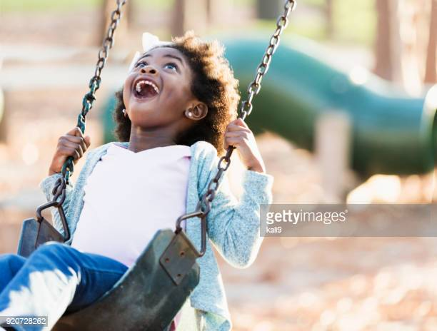 african-american girl on a swing - swinging stock pictures, royalty-free photos & images
