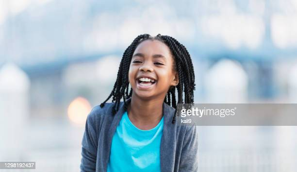 african-american girl on city waterfront - primary age child stock pictures, royalty-free photos & images