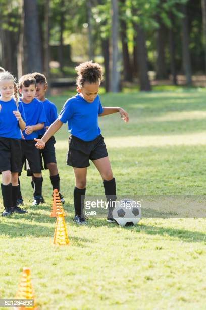 African-American girl on soccer team practicing