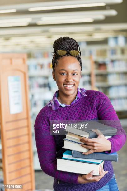 african-american high school student with stack of books - female high school student stock pictures, royalty-free photos & images