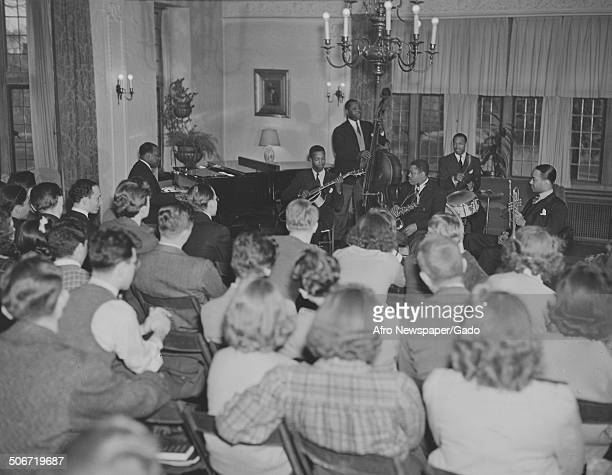 AfricanAmerican jazz musician Count Basie and a Jazz orchestra playing music at Washington University of Saint Louis Saint Louis Missouri 1952