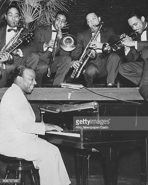 AfricanAmerican jazz musician Count Basie and a Jazz orchestra playing the piano 1945