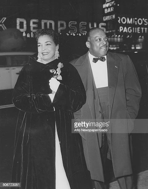 AfricanAmerican jazz musician Count Basie and Catherine Basie attending a Carmen Jones opening October 28 1954