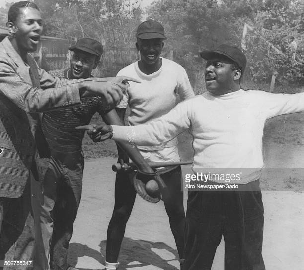 AfricanAmerican jazz musician Count Basie and other men playing baseball June 14 1947