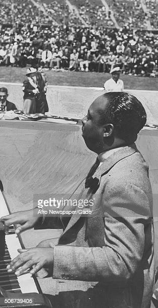 AfricanAmerican jazz musician Count Basie playing the piano during the Great Carnival of Swing Randalls Island New York 1938