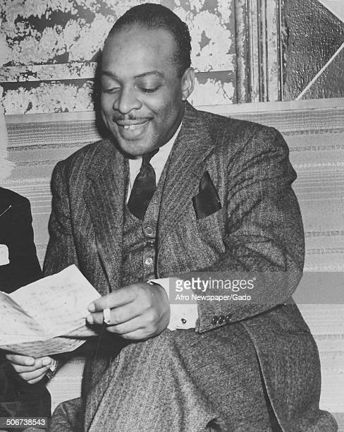AfricanAmerican jazz musician Count Basie reading a paper December 3 1938
