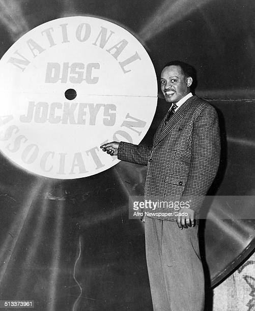 AfricanAmerican jazz vibraphonist pianist percussionist bandleader and actor Lionel Hampton with a vinyl record 1957