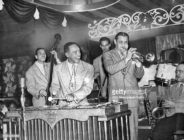 AfricanAmerican jazz vibraphonist pianist percussionist bandleader and actor Lionel Hampton Jazz musician Ziggy Elman and a Jazz orchestra playing...