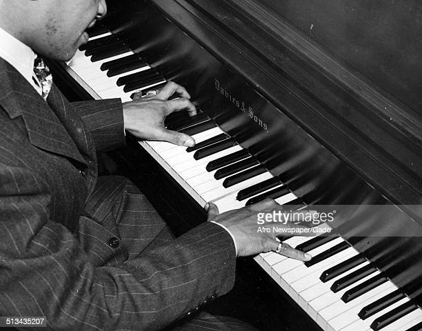 AfricanAmerican jazz vibraphonist pianist percussionist bandleader and actor Lionel Hampton playing the piano 1941