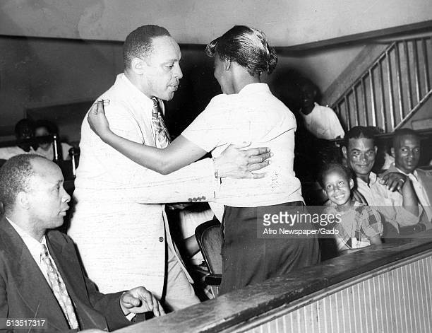 AfricanAmerican jazz vibraphonist pianist percussionist bandleader and actor Lionel Hampton and a girl dancing during a concert June 21 1947