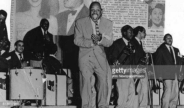 AfricanAmerican jazz vibraphonist pianist percussionist bandleader and actor Lionel Hampton a Jazz orchestra Sonny Parker and vocalist Lorene Carter...
