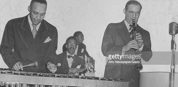AfricanAmerican jazz vibraphonist pianist percussionist bandleader and actor Lionel Hampton and a Jazz orchestra playing instruments and singing...