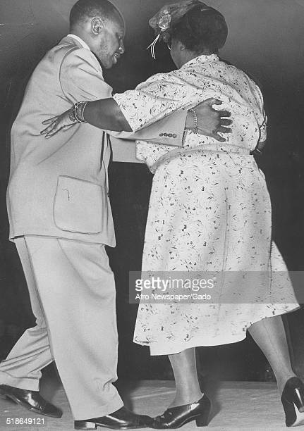 AfricanAmerican jazz vibraphonist pianist percussionist bandleader and actor Lionel Hampton and woman dancing April 16 1949