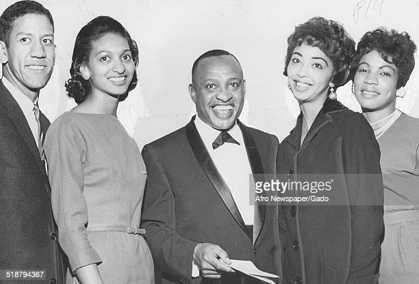 AfricanAmerican jazz vibraphonist pianist percussionist bandleader and actor Lionel Hampton and college students at Virginia State College Virginia...