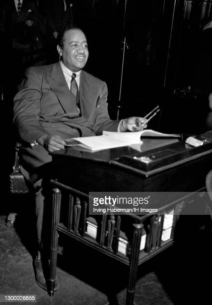 African-American lawyer and communist who was elected in 1943 to the city council of New York City, representing Harlem, Ben J. Davis Jr. Smiles...