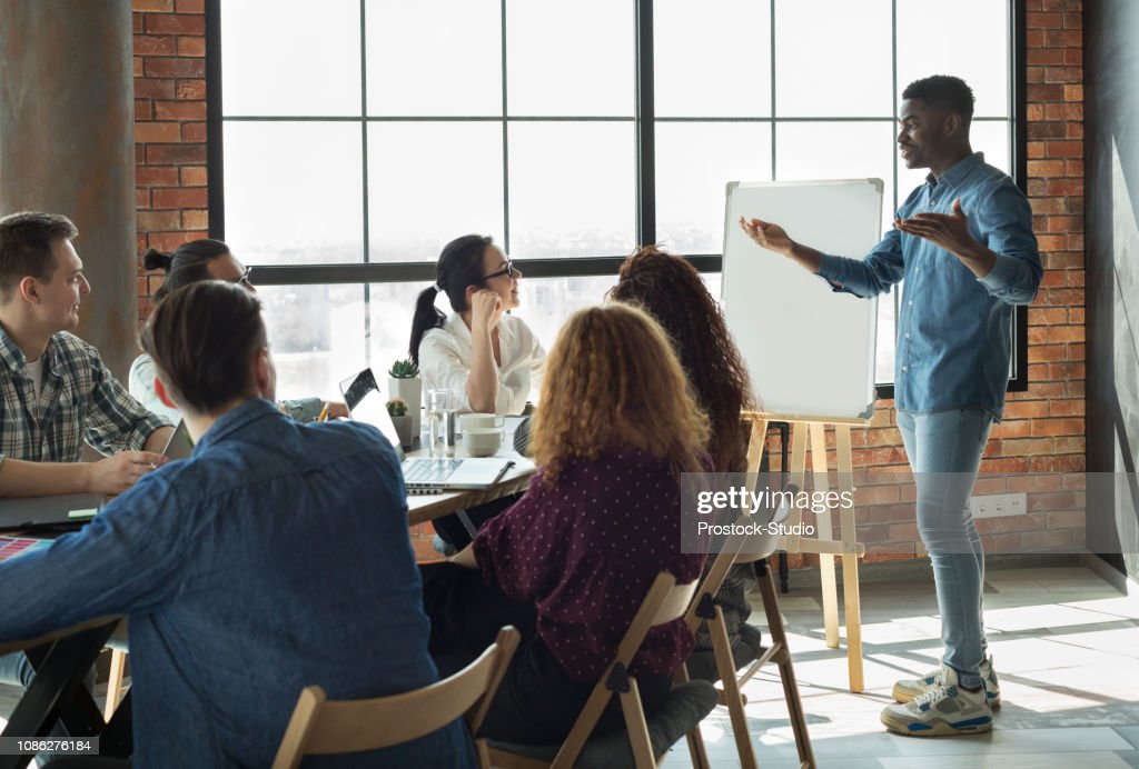 African-american leader lecturing his employees in office : Stock Photo