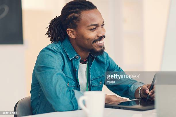 African-American Male Graphic Designer At Work.