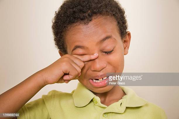 african-american male (8 years old) rubbing his eyes - 8 9 years stock pictures, royalty-free photos & images